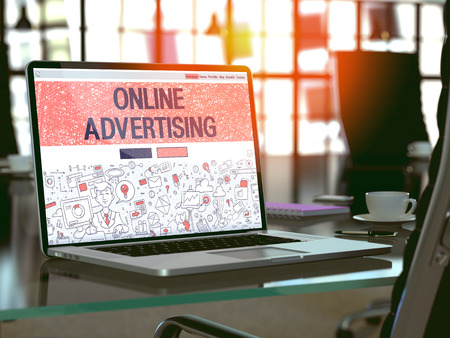 interstitial: Online Advertising Concept. Closeup Landing Page on Laptop Screen in Doodle Design Style. On Background of Comfortable Working Place in Modern Office. Blurred, Toned Image. 3D Render.