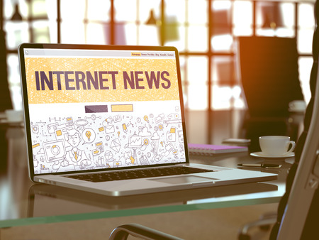 current events: Internet News Concept. Closeup Landing Page on Laptop Screen in Doodle Design Style. On Background of Comfortable Working Place in Modern Office. Blurred, Toned Image.  3D Render. Stock Photo