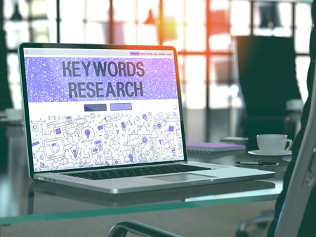 keywords: Keywords Research - Closeup Landing Page in Doodle Design Style on Laptop Screen. On Background of Comfortable Working Place in Modern Office. Toned, Blurred Image. 3D Render.