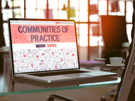 rationale: Modern Workplace with Laptop showing Landing Page in Doodle Design Style with text Communities Of Practice. Toned Image with Selective Focus. 3d Render.