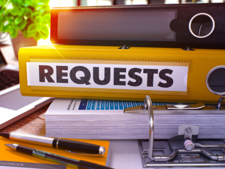 requests: Requests - Yellow Ring Binder on Office Desktop with Office Supplies and Modern Laptop. Requests Business Concept on Blurred Background. Requests - Toned Illustration. 3D Render. Stock Photo