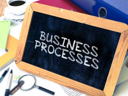 Business Processes Concept Hand Drawn on Chalkboard on Working Table Background. Blurred Background. Toned Image. 3D Render.
