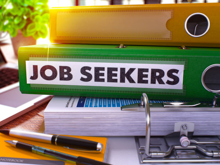 seekers: Green Office Folder with Inscription Job Seekers on Office Desktop with Office Supplies and Modern Laptop. Job Seekers Business Concept on Blurred Background. Job Seekers - Toned Image. 3D. Stock Photo