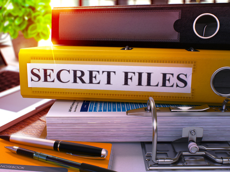 arcanum: Yellow Office Folder with Inscription Secret Files on Office Desktop with Office Supplies and Modern Laptop. Secret Files Business Concept on Blurred Background. Secret Files - Toned Image. 3D.