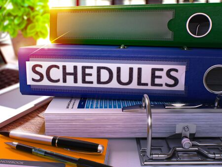 injunction: Blue Office Folder with Inscription Schedules on Office Desktop with Office Supplies and Modern Laptop. Schedules Business Concept on Blurred Background. Schedules - Toned Image. 3D.