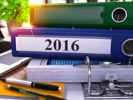 christmas budget: 2016 - Blue Office Folder on Background of Working Table with Stationery and Laptop. 2016 Business Concept on Blurred Background. 2016 Toned Image. 3D.