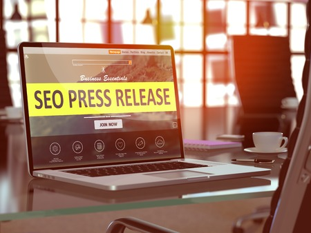 SEO - Search Engine Optimization - Press Release Concept. Closeup Landing Page on Laptop Screen  on background of Comfortable Working Place in Modern Office. Blurred, Toned Image. 3D Render. Stock Photo - 52339427