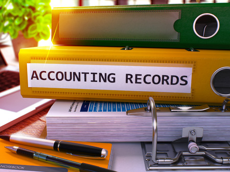 bank records: Accounting Records - Yellow Ring Binder on Office Desktop with Office Supplies and Modern Laptop. Accounting Records Business Concept on Blurred Background. 3D Render. Stock Photo