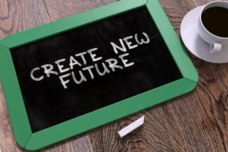 attainment: Create New Future - Green Chalkboard with Hand Drawn Text and White Cup of Coffee on Wooden Table. Top View. 3D Render. Stock Photo