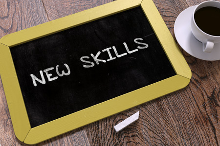 learning new skills: New Skills Concept Hand Drawn on Yellow Chalkboard on Wooden Table. Business Background. Top View. 3D Render.