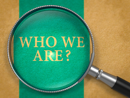 Who We Are Question through Magnifier on Old Paper with Blue Vertical Line Background. 3D Render. Stock Photo