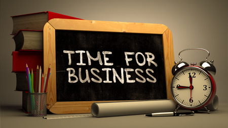 amendment: Handwritten Time for Business on a Chalkboard. Composition with Chalkboard and Stack of Books, Alarm Clock and Rolls of Paper on Blurred Background. Toned Image. 3D Render.
