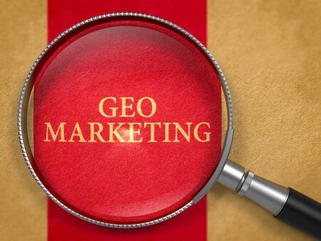 geo: Geo Marketing Concept through Magnifier on Old Paper with Dark Red Vertical Line Background. 3D Render.
