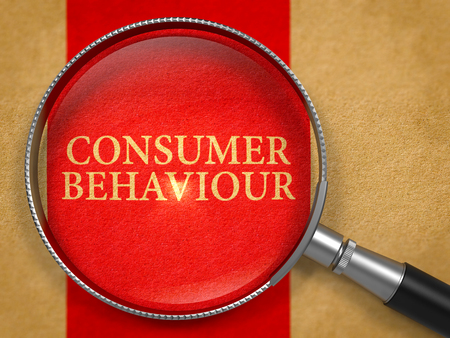 consumer: Consumer Behaviour through Loupe on Old Paper with Red Vertical Line Background. 3D Render. Stock Photo