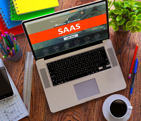 saas fee: SaaS - Software as a Service - on Laptop Screen. E-Business Concept. Stock Photo