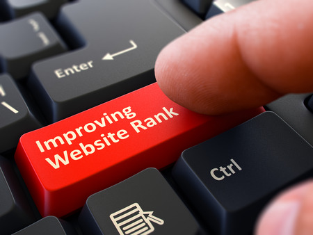 improving: Improving Website Rank - Written on Red Keyboard Key. Male Hand Presses Button on Black PC Keyboard. Closeup View. Blurred Background. 3D Render.