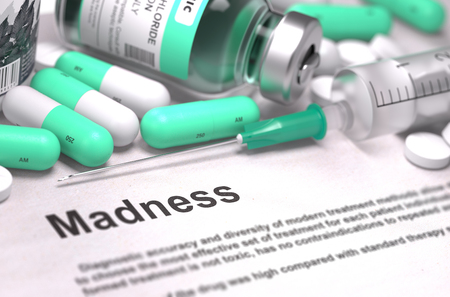life threatening: Diagnosis - Madness. Medical Report with Composition of Medicaments - Light Green Pills, Injections and Syringe. Blurred Background with Selective Focus. 3D Render. Stock Photo