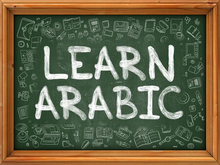 polyglot: Learn Arabic - Handwritten Inscription by Chalk on Green Chalkboard with Doodle Icons Around. Modern Style with Doodle Design Icons. Learn Arabic on Background of  Green Chalkboard with Wood Border.