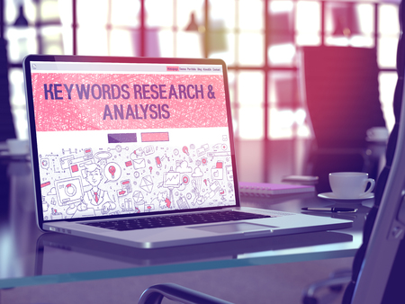 meta analysis: Modern Workplace with Laptop Showing Landing Page in Doodle Design Style with Text Keywords Research and Analysis. Toned Image with Selective Focus. 3D Render.