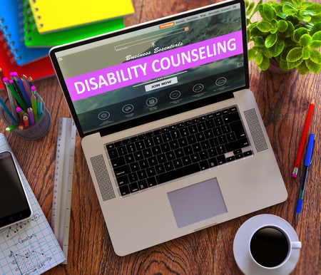 stationery needs: Disability Counseling Concept. Modern Laptop and Different Office Supply on Wooden Desktop Background. 3D Render. Stock Photo