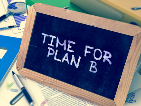 unforeseen: Time for Plan B Handwritten on Chalkboard. Composition with Small Chalkboard on Background of Working Table with Ring Binders, Office Supplies, Reports. Blurred Background. Toned Image. 3D Render.