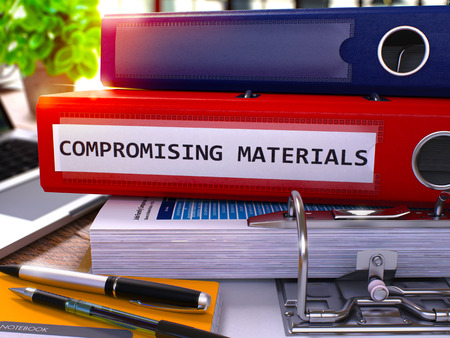 extortion: Compromising Materials - Red Office Folder on Background of Working Table with Stationery and Laptop. Compromising Materials Business Concept on Blurred Background. 3D Render.