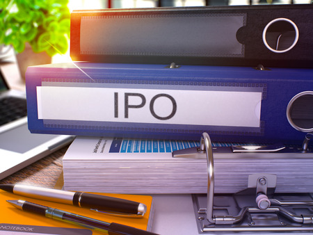 initial public offerings: Blue Office Folder with Inscription IPO - Initial Public Offering - on Office Desktop with Office Supplies and Modern Laptop. IPO Business Concept on Blurred Background. IPO - Toned Image. 3D Render.