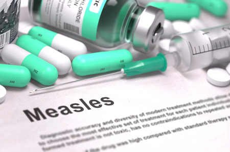 measles: Diagnosis - Measles. Medical Report with Composition of Medicaments - Light Green Pills, Injections and Syringe. Blurred Background with Selective Focus. 3D Render. Stock Photo