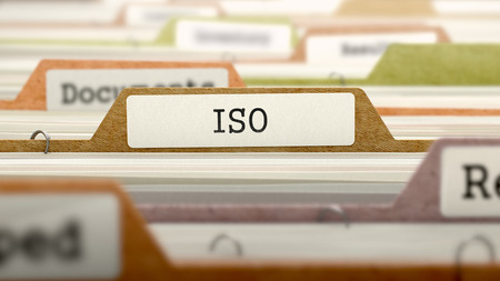 File Folder Labeled as ISO - International Organization Standardization - in Multicolor Archive. Closeup View. Blurred Image. 3D Render.