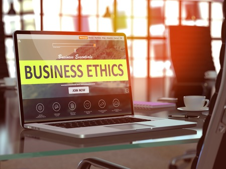Business Ethics Concept. Closeup Landing Page on Laptop Screen  on background of Comfortable Working Place in Modern Office. Blurred, Toned Image. 3D Render. Stock Photo