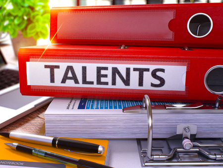 knack: Talents - Red Office Folder on Background of Working Table with Stationery and Laptop. Talents Business Concept on Blurred Background. Talents Toned Image. 3D. Stock Photo