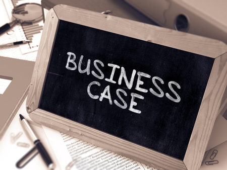 business case: Business Case Handwritten by White Chalk on a Blackboard. Composition with Small Chalkboard on Background of Working Table with Office Folders, Stationery, Reports. Blurred, Toned Image. 3D Render. Stock Photo