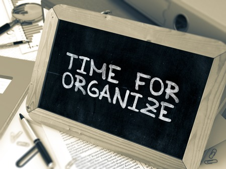 organize: Time for Organize - Chalkboard with Hand Drawn Text, Stack of Office Folders, Stationery, Reports on Blurred Background. Toned Image. 3D Render.