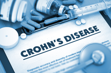 crohn's disease: Crohns Disease - Printed Diagnosis with Blurred Text. Crohns Disease, Medical Concept with Pills, Injections and Syringe. 3D Render. Stock Photo