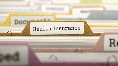 marked: Folder in Colored Catalog Marked as Health Insurance Closeup View. Selective Focus. 3D Render.