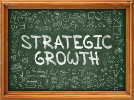 accomplish: Strategic Growth - Hand Drawn on Chalkboard. Strategic Growth with Doodle Icons Around.