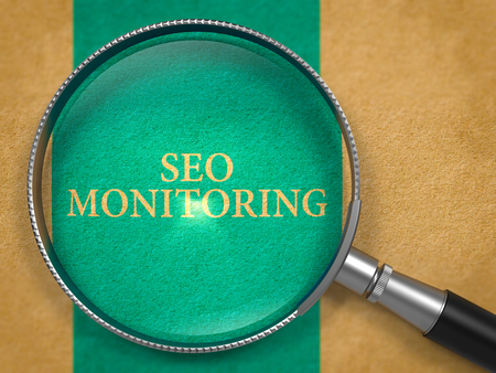 SEO - Search Engine Optimization - Monitoring through Loupe on Old Paper with Blue Vertical Line Background. 3D Render. Stock Photo