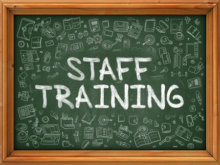 staff training: Hand Drawn Staff Training on Green Chalkboard. Hand Drawn Doodle Icons Around Chalkboard. Modern Illustration with Line Style. Stock Photo