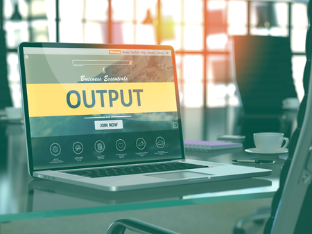 output: Modern Workplace with Laptop showing Landing Page with Output Concept. Toned Image with Selective Focus. 3D Render. Stock Photo
