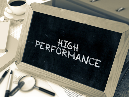 high performance: High Performance Handwritten on Chalkboard. Composition with Small Chalkboard on Background of Working Table with Ring Binders, Office Supplies, Reports. Blurred Background. Toned Image. 3D Render. Stock Photo