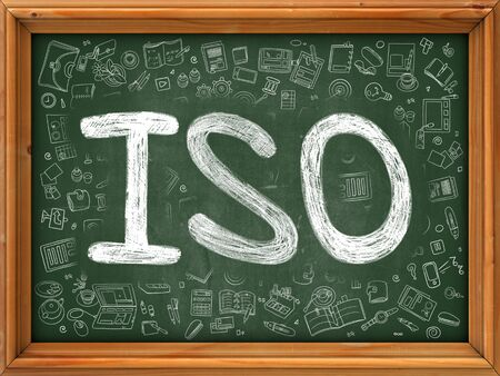 standardization: Green Chalkboard with Hand Drawn  ISO - International Organization Standardization - with Doodle Icons Around. Line Style Illustration. Stock Photo