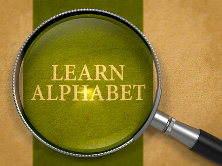 dark green: Learn Alphabet through Magnifying Glass on Old Paper with Dark Green Vertical Line Background. 3D Render. Stock Photo