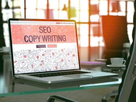 copywriting: SEO Copywriting Concept. Closeup Landing Page on Laptop Screen in Doodle Design Style. On Background of Comfortable Working Place. Blurred, Toned Image. 3D Render.