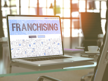 franchising: Franchising Concept - Closeup on Landing Page of Laptop Screen in Modern Office Workplace. Toned Image with Selective Focus. 3D Render. Stock Photo