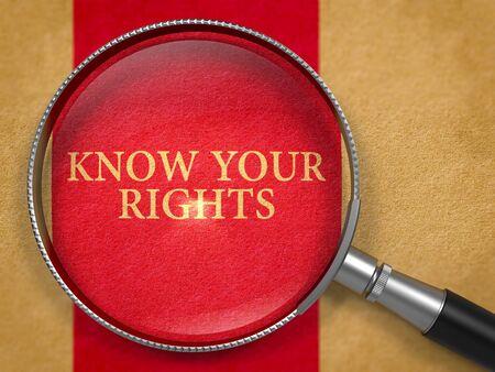 conflictos sociales: Conozca sus derechos a trav�s de la lupa en el papel viejo con el fondo oscuro l�nea roja vertical. Render 3D. Foto de archivo