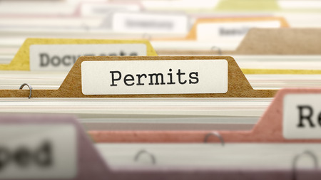 permits: Folder in Colored Catalog Marked as Permits Closeup View. Selective Focus. 3D Render. Stock Photo
