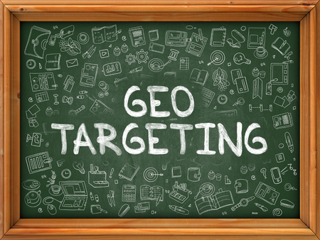 targeting: Geo Targeting - Hand Drawn on Green Chalkboard with Doodle Icons Around. Modern Illustration with Doodle Design Style. Stock Photo