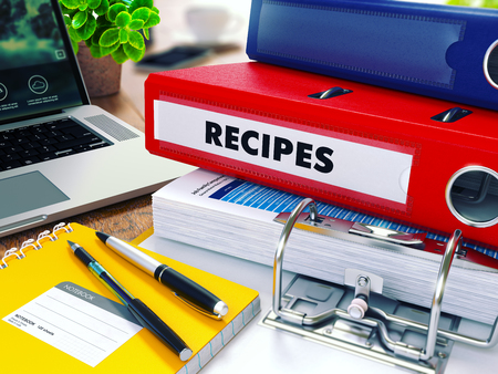 injunction: Recipes - Red Ring Binder on Office Desktop with Office Supplies and Modern Laptop. Business Concept on Blurred Background. Toned Illustration. 3D Render.