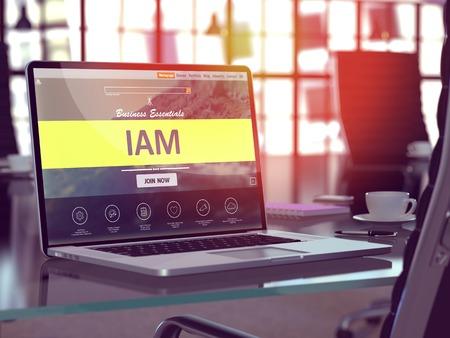 Lugar de trabajo moderno con la computadora portátil que muestra la página de destino con IAM - Access Management Identidad - Concepto. Imagen virada con enfoque selectivo. Render 3D.