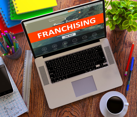 franchising: Franchising on Landing Page of Laptop Screen. Business Concept. 3D Render.
